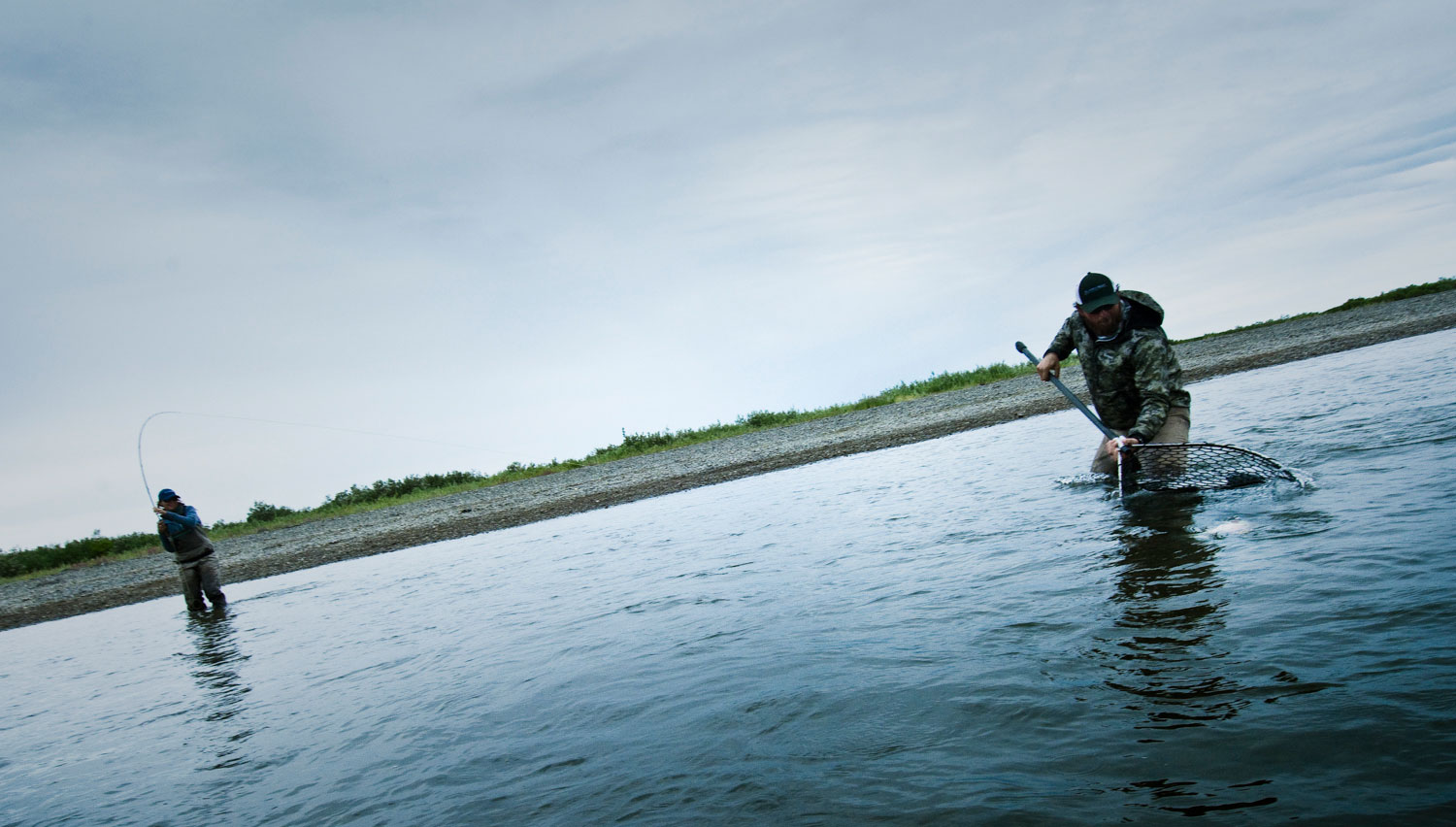 A team approach to landing big fish fly fishing gink for Fly fishing jobs