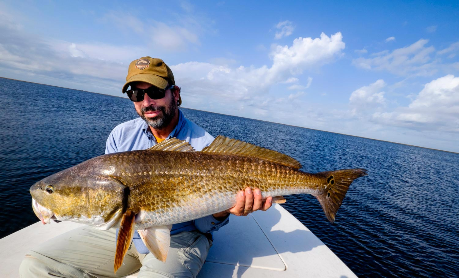 Florida lowers limits to increase redfish numbers fly for Fly fishing redfish